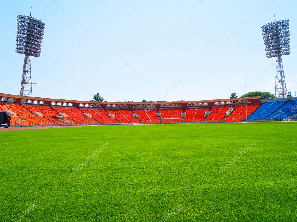 Empty green football field with seats at stadium  — Stock Photo #5801565