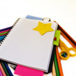 Blank note book with school supplies — Stock Photo