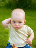 Wondering small caucasian baby — Stock Photo