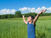 Happy boy on wheat field — Stock Photo
