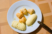 Plate of butter — Stock Photo