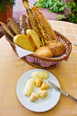 Bread backet with plate of butter — Stock Photo