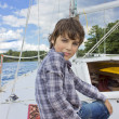Boy sailng on yacht — Stock Photo