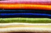 Stack of brightly coloured fluffy alpaca blankets — Stock Photo