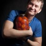 Guy & tomatoes — Stock Photo