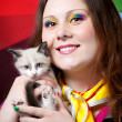 Kitten and Woman with rainbow make up — Stock Photo