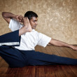 Yoga akarna dhanurasana archer pose — Stock Photo