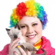 Kitten and clown with rainbow make up — Stock Photo