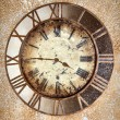 Ancient vintage clock on grunge wall — Stock Photo