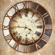 Stock Photo: Ancient vintage clock on grunge wall