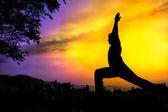 Yoga silhouette virabhadrasana I warrior pose — Stock Photo