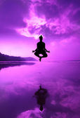 Yoga padmasana in jumping on the beach — Stock Photo