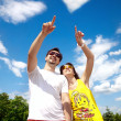 Couple pointing at cloud heart — Stock Photo