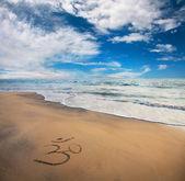 Om symbol on the beach — Stock Photo