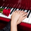 Hands of married couple on piano - Stock Photo