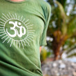 Om symbol on green t-shirt - Stok fotoğraf