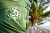 Om symbol on green t-shirt — Stock Photo