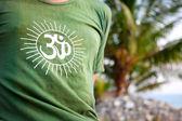 Om symbol on green t-shirt — Stock Photo