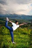 Yoga natarajasana dancer pose in mountains — Stock Photo