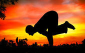 Yoga silhouette bakasana crane pose — Stock Photo