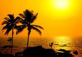 Silhouette of Yoga natarajasana at sunset — Stock Photo