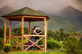 Young couple in mountains — Stock Photo