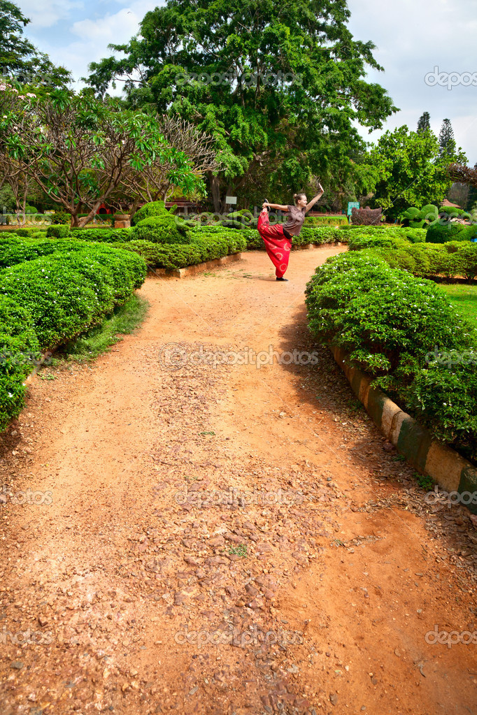 Yoga natarajasana dancer pose in lalbagh garden stock for Gardening tools in bangalore