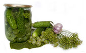 Canned cucumbers with gooseberries — Stock Photo