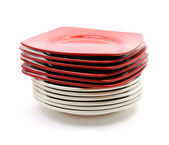 Pile of red and white plates — Stock Photo