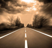 Blurred Road with blurred sky and sunset — Stock Photo