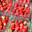 Lot of strawberries on the market — Stock Photo