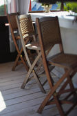 Chairs at bar counter — Stock Photo