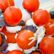 Small tomatos with mozzarella on skewer — Stock Photo