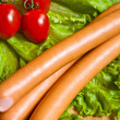 Sausage on green lettuce — Foto de Stock