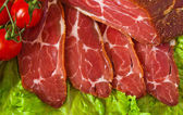 Cut meat delicious with cerry and lattuce — Stock Photo