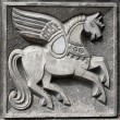 Old bas-relief of fairytale winged horse - Stock Photo