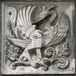 Stock Photo: Old bas-relief of fairytale firebird