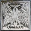 Stock Photo: Old bas-relief of fairytale two eagles