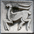 Old bas-relief of fairytale deer - Stock Photo