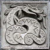 Bas-relief of fairytale snake — Stock Photo