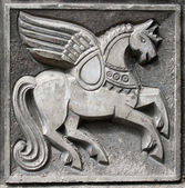 Old bas-relief of fairytale winged horse — 图库照片