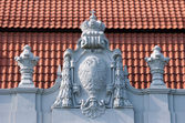 Old bas-relief on the roof — Stock Photo