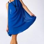 Young beautiful girl in blue dress — Stock Photo