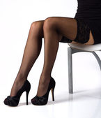 Sexy legs in black stockings — Stock fotografie
