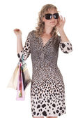 Pretty woman makes shopping — Stockfoto