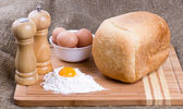 Yolk, eggs of house hens, salt, pepper and fresh hot home-made bread with w — Stock Photo