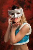 Cute snow maiden in silver mask — Stock Photo