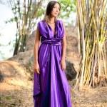 Beautiful woman wearing a long purple dress — Stock Photo #5613724