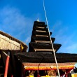 Decorated balinese multiroofed shrine - Stock Photo