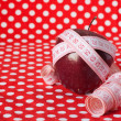 Red apple and measuring tape - Stock Photo